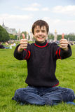 Cheerful teenager shows thumb up on the Esplanade des Invalides Royalty Free Stock Photos