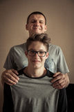 Cheerful teenager son with father portrait royalty free stock image