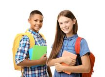 Teenagers with backpacks holding notebooks on white background. Cheerful teenagers with backpacks holding notebooks on white background royalty free stock photos