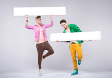 Cheerful teenagers wearing colorful clothes Royalty Free Stock Photo