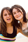 Cheerful teens. Two happy cheerful young teens girls on beach Stock Images