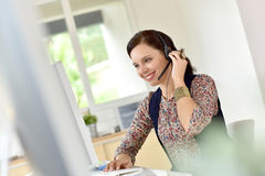 Cheerful telemarketing woman Stock Photos