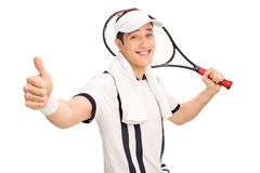 Cheerful tennis player holding a racket. And giving a thumb up isolated on white background Stock Photography