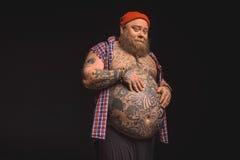 Cheerful thick guy likes his tummy Stock Photo