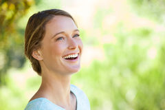 Cheerful thoughtful woman looking away in park Stock Photo