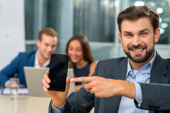Cheerful three business partners in conference hall Royalty Free Stock Photo