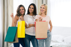Cheerful three girls with many shopping bags Royalty Free Stock Photography