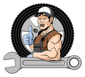 Cheerful tire specialist Royalty Free Stock Photos