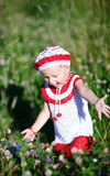 Cheerful toddler girl in meadow Stock Photos