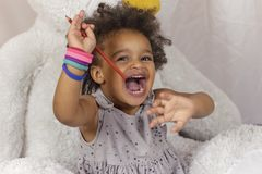 Cheerful toddler having fun stock photography