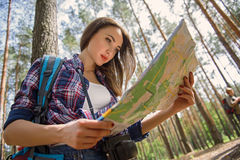 Cheerful tourist navigating in nature Stock Photos