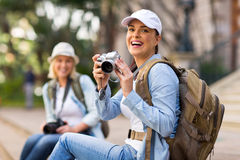 Cheerful tourist. Portrait of cheerful tourist holding a camera Stock Photography