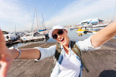 Cheerful tourist selfie wharf Stock Photos