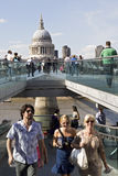 Cheerful tourists crossing millenium bridge Stock Photo