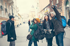 Cheerful Tourists Sightseeing City Stock Photo