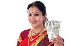 Cheerful traditional woman holding Indian currency Royalty Free Stock Photos