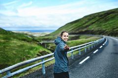 Cheerful traveler on background of road stock photography