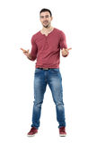 Cheerful trendy casual man smiling and pointing at camera choosing you. Full body length portrait isolated over white background Royalty Free Stock Image
