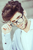Cheerful trendy guy with black eyeglasses on Stock Image