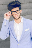 Cheerful trendy guy with black eyeglasses on Royalty Free Stock Images
