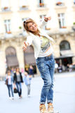Cheerful trendy woman having fun in the streets Stock Photography