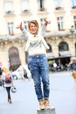 Cheerful trendy woman having fun wth thumbs up Royalty Free Stock Photography