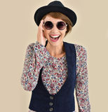 Cheerful trendy woman presenting retro sunglasses collection Royalty Free Stock Image