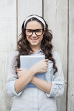 Cheerful trendy woman with stylish glasses holding her tablet Stock Photo
