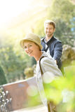 Cheerful trendy young couple in the park Stock Photo