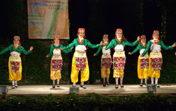 Cheerful Turkish dancers in folk costumes on stage Royalty Free Stock Photo