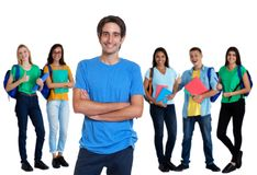 Cheerful turkish young adult man with other students royalty free stock photos
