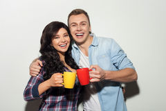 Cheerful two friends are enjoying hot drink Royalty Free Stock Photo