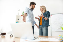 Cheerful two office workers are discussing their assignment royalty free stock photos