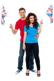 Cheerful UK supporters posing together Stock Photo