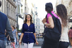 Cheerful urban girl at a city street Royalty Free Stock Images