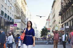Cheerful urban girl at a city street Royalty Free Stock Photo