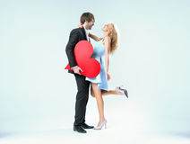 Cheerful valentine's couple in a hug Stock Images