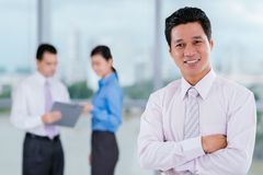 Cheerful Vietnamese manager Royalty Free Stock Photography