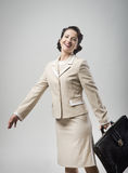 Cheerful vintage woman walking with briefcase Royalty Free Stock Images