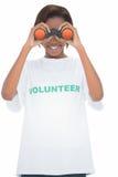 Cheerful volunteer woman looking through binoculars Royalty Free Stock Photo