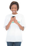 Cheerful volunteer woman looking at her mobile phone Royalty Free Stock Photos