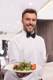 Cheerful waiter. Stock Photography
