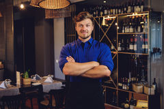 Cheerful waiter in modern restaurant.  Stock Image