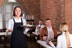Cheerful waiter showing country restaurant Stock Photo