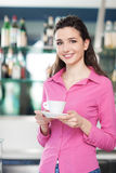 Cheerful waitress in a coffee shop Royalty Free Stock Images