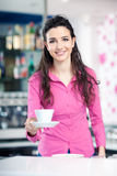 Cheerful waitress in a coffee shop Stock Photo