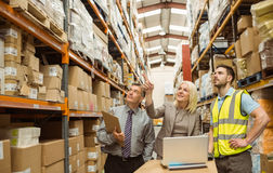 Cheerful warehouse team working together Royalty Free Stock Photo