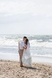 Cheerful wedding couple on the beach Stock Photography