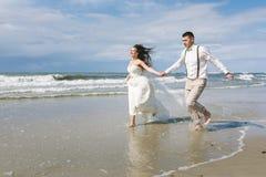 Cheerful wedding couple on the beach Royalty Free Stock Photo