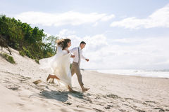 Cheerful wedding couple on the beach Stock Photo